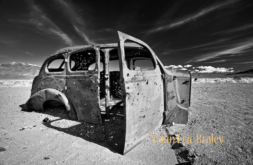 The shelll of a vintage car is filled with bullet holes as it rests in the desert wilderness of southwestern Nevada near Tonopah Junction in Esmeralda County. Colin E Braley (Wild West-Media)
