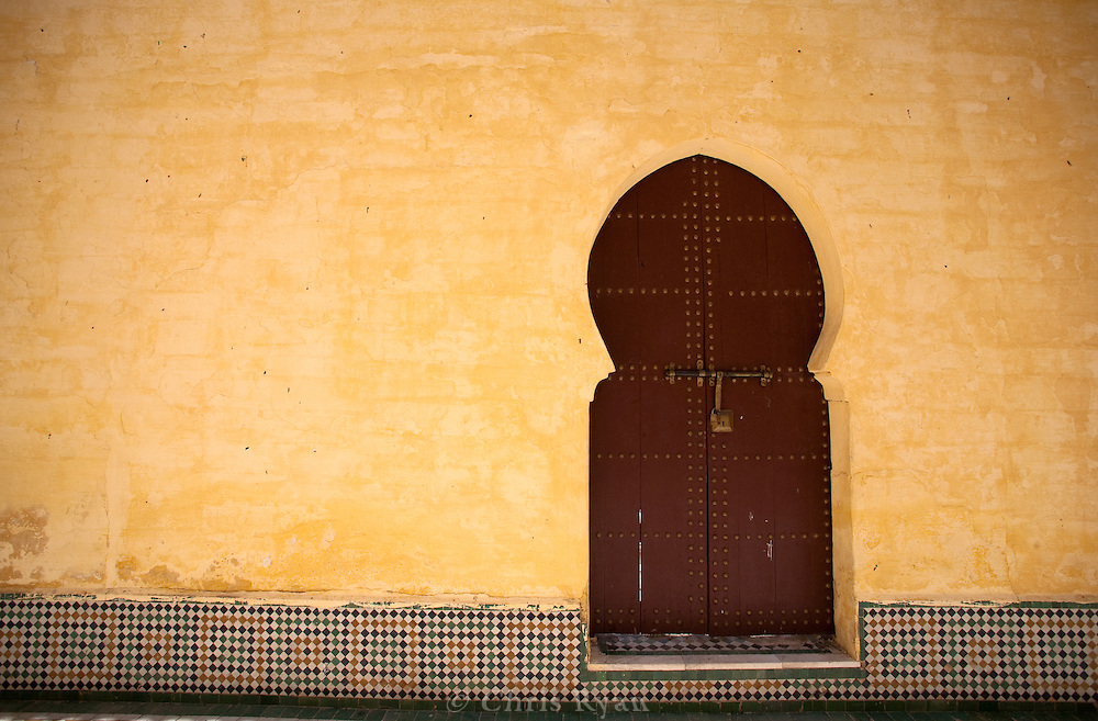 Door and yellow wall in Moulay Ismail Mausoleum, Meknes, Morocco