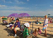 Brooklyn, New York, USA. 10th August 2013.  Families and other visitors are on the world famous boardwalk and beach at Coney Island, during the 3rd Annual Coney Island History Day.