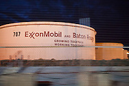"""Oil tanks at the Exxon Mobile refinery in Baton Rouge, Louisiana located in the stretch between Baton Rouge and New Orleans along the river, is part of a large concentration of chemical and oil companies that was formerly referred to as the """"Petrochemical Corridor,"""" but now is know as """"Cancer Alley.""""  Many cases of cancer have occurred  in communities on both sides of the river though the Louisiana Tumor Registry claims the numbers are not higher then the national average. The record high levels of the Mississippi River in the spring of 2011 brought on by what some scientists clasify as climate change,  threaten the environment with the potential flooding of industrial complexes and nuclear facilities along the river."""
