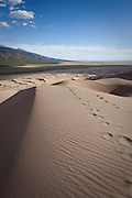 Foot tracks cross the dunes, Great Sand Dunes National Park, Colorado.