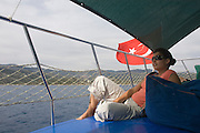 Turkey, Antalya Province, Kas A female tourist at the fishing harbour Model Release Available