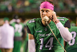 Oct 9, 2015; Huntington, WV, USA; Marshall Thundering Herd quarterback Chase Litton talks on the phone during the fourth quarter against the Southern Miss Golden Eagles at Joan C. Edwards Stadium. Mandatory Credit: Ben Queen-USA TODAY Sports