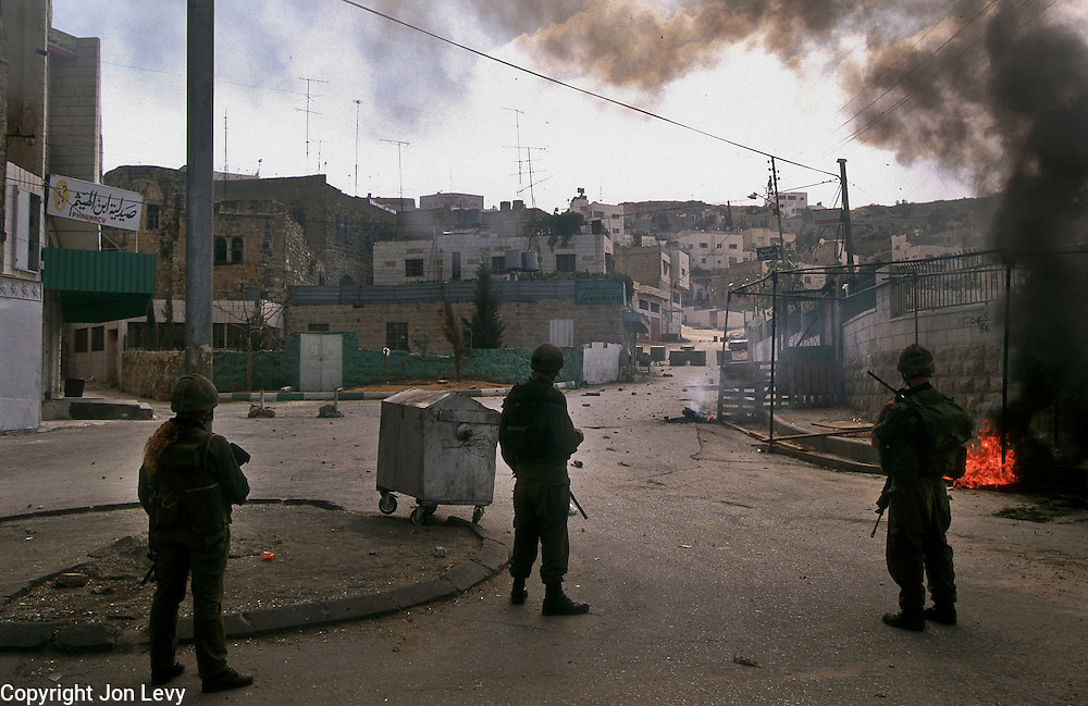 Radical Jewsih settlers occupy the West Bank Palestinian town of Hebron. The small Jewish minority has effectively partitioned the twon with a large Israeli army presence to enforce the separation.