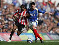 Photo: Lee Earle.<br /> Portsmouth v Sunderland. The Barclays Premiership. 22/04/2006. Sunderland's Justin Hoyte (L) battles with Richard Hughes.