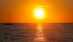 THEMENBILD - URLAUB IN KROATIEN, ein Boot im Meer, bei Sonnenuntergang, aufgenommen am 03.07.2014 in Porec, Kroatien // a boat in the sea at sunset at Porec, Croatia on 2014/07/03. EXPA Pictures © 2014, PhotoCredit: EXPA/ JFK