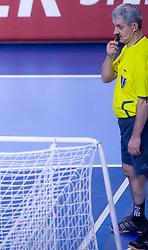 Referee with earphones during 21st Men's World Handball Championship preliminary Group D match between Denmark and Saudi Arabia, on January 19, 2009, in Arena Zatika, Porec, Croatia. Win of Denmark 32:13. (Photo by Vid Ponikvar / Sportida)