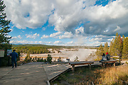 Tourists on walkway at Upper Geyser Basin, Yellowstone National Park, Wyoming.