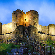 A dusk panorama of Harlech Castle in Harlech, Gwynedd, on the northwest coast of Wales next to the Irish Sea. The castle was built by Edward I in the closing decades of the 13th century as one of several castles designed to consolidate his conquest of Wales.
