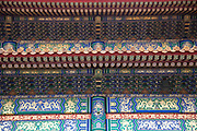 Detail of an ornate painted roof in The Forbidden City was the Chinese imperial palace from the Ming Dynasty to the end of the Qing Dynasty. It is located in the middle of Beijing, China, and now houses the Palace Museum. For almost 500 years, it served as the home of emperors and their households, as well as the ceremonial and political center of Chinese government. Built in 1406 to 1420, the complex consists of 980 buildings. The palace complex exemplifies traditional Chinese palatial architecture, and has influenced cultural and architectural developments in East Asia and elsewhere. The Forbidden City was declared a World Heritage Site in 1987, and is listed by UNESCO as the largest collection of preserved ancient wooden structures in the world.