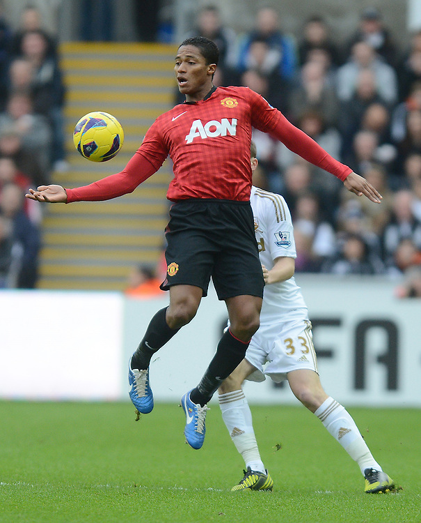 Manchester United's Luis Antonio Valencia jumps to bring the ball down under control ..Football - Barclays Premiership - Swansea City v Manchester United - Sunday 23rd December 2012 - The Liberty Stadium - Swansea..