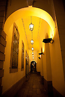 Looking down an arched balcony of an old portuguese colonial building in Macau.