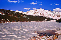 A frozen Clinton Reservoir below the snow covered 13,951 ft. Fletcher Mountain along the Continental Divide of the Ten Mile Range.  Colorado.