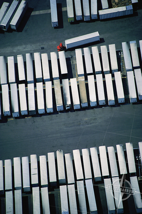 Tractor trailers in shipping depot.