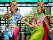 21 AUGUST 2015 - BANGKOK, THAILAND: Thai dancers perform at the Erawan Shrine Friday. Traditionally, people who want to make merit pay the dancers to perform while they pray. The Bangkok Metropolitan Administration (BMA) held a religious ceremony Friday for the Ratchaprasong bomb victims. The ceremony started with a Brahmin blessing at Erawan Shrine, which was the target of a bombing Monday night. After the blessing people went across the street to the plaza in front of Central World mall for an interfaith religious service. Theravada Buddhists, Mahayana Buddhists, Muslims, Sikhs, Hindus, and Christians participated in the service. Life at the shrine, one of the busiest in Bangkok, is returning to normal. Friday the dancers and musicians who perform at the shrine resumed their schedules.       PHOTO BY JACK KURTZ