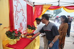 May 18, 2017 - Scarborough, Ontario, Canada - Tamils lay flowers at a make-shift memorial during Tamil Genocide Remembrance Day on May 18 2017 in Scarborough, Ontario, Canada. Tamils gathered to remember the victims of the civil war in Northern Sri Lanka that claimed countless lives and caused massive destruction. Many Tamils around the globe have been pushing for a referendum in 2020 calling for an independent Tamil state in Sri Lanka called Tamil Eelam. (Credit Image: © Creative Touch Imaging Ltd/NurPhoto via ZUMA Press)