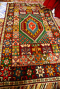 Interior of a nomad tent hand made carpets on the floor Photographed in Morocco