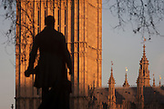 "The silhouetted statue of Sir Robert Peel and the Elizabeth Tower of the British parliament, on 17th January 2017, in London England. The Elizabeth Tower (previously called the Clock Tower) named in tribute to Queen Elizabeth II in her Diamond Jubilee year – was raised as a part of Charles Barry's design for a new palace, after the old Palace of Westminster was largely destroyed by fire on the night of 16 October 1834. The new Parliament was built in a Neo-gothic style, completed in 1858 and is one of the most prominent symbols of both London and England. Sir Robert Peel, was a British statesman and member of the Conservative Party, served twice as Prime Minister of the United Kingdom and twice as Home Secretary. He created the modern police force and officers known as ""bobbies"" and ""peelers"""