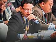 "29 MAY 2015 - BANGKOK, THAILAND:   HTIN LYNN, Special Representative of the Myanmar Ministry of Foreign Affairs, takes notes while the UNHCR representative talks about Myanmar's treatment of ethnic minorities in Myanmar, including the Rohingya, during the ""Special Meeting on Irregular Migration in the Indian Ocean."" Thailand organized and hosted the meeting at the Anantara Siam Hotel in Bangkok. The meeting brought together representatives from the 5 countries impacted by the boat people exodus: Thailand, Malaysia and Indonesia, which have all received boat people, and Myanmar (Burma) and Bangladesh, where they are coming from. Non-governmental organizations, like the International Organization for Migration (IOM) and UN High Commissioner for Refugees (UNHCR) as well as countries responding to the crisis, like the United States, also attended the meeting. A total of 22 organizations attended the one day conference.    PHOTO BY JACK KURTZ"