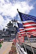USA flags line the approach to the USS Missouri, permanently berthed at the Battleship Missouri Memorial, Pearl Harbour, Hawaii. RIGHTS MANAGED LICENSE AVAILABLE FROM www.PhotoLibrary.com