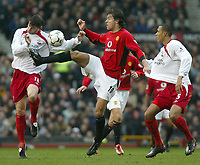 Photo. Andrew Unwin.<br /> Manchester United v Southampton, Barclaycard Premier League, Old Trafford, Manchester 31/01/2004.<br /> Southampton's Rory Delap (l) gets a boot in the face from Manchester United's Ruud van Nistelroy (c).