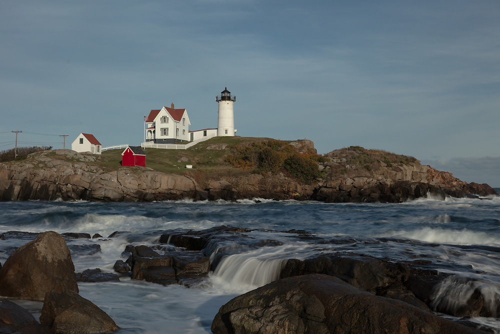 Waves rolling into the rocky coast of Cape Neddick on an autumn afternoon.