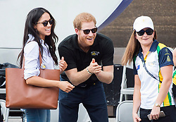 RETRANSMISSION FOR IMPROVED TONING Prince Harry, centre, reacts to fans with his girlfriend Meghan Markle, left, after watching the wheelchair tennis competition during the Invictus Games in Toronto, ON, Canada, Monday September 25, 2017. This is Prince Harry's first public appearance with Markle. Photo by Nathan Denette/CP/ABACAPRESS.COM
