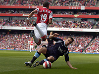 Photo: Olly Greenwood.<br />Arsenal v West Ham United. The Barclays Premiership. 07/04/2007. Arsenal's Gilberto tackled by West Ham's Mark Noble