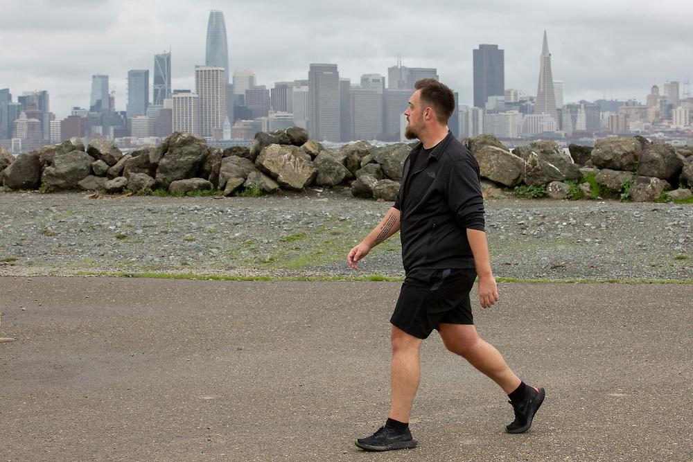 A jogger exercises on Treasure Island on Thursday, Jan. 31, 2019, in San Francisco, Calif.