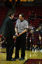 12 February 2011: Tim Jankovich and referee Brad Gaston have a chat during a time out during an NCAA Missouri Valley Conference basketball game between the Missouri State Bears and the Illinois State Redbirds at Redbird Arena in Normal Illinois.