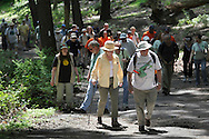 Bear Mountain, New York - Hikers walk up to the start of a new trail section during National Trails Day on the Appalachian Trail at Bear Mountain on June 5, 2010. A ceremony and hike celebrated the reconstruction of this original section of the Appalachian Trail. More than 800 volunteers, along with professionals, built 800 hand-hewn rock steps and a broad, gently sloping trail bed atop nearly a mile of rock wall built to sustain the traffic of more than 500,000 hikers annually.