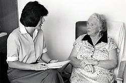 Dietician & elderly woman, Queen's Medical Centre, Nottingham, UK 1990