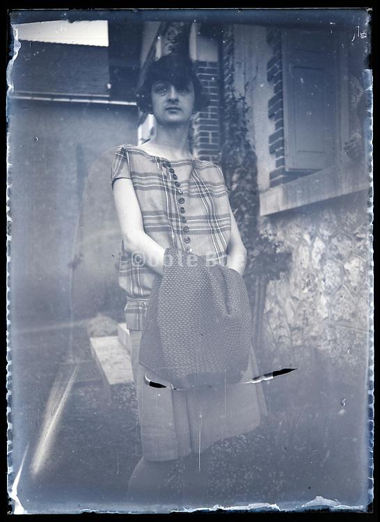 woman standing in backyard France circa 1930s
