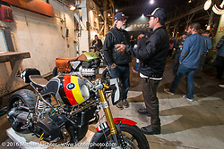 Brandon Holstein and Jeff Wright check out Jeff's custom RnineT on Friday night at the One Show motorcycle show in Portland, OR. February 12, 2016. ©2016 Michael Lichter