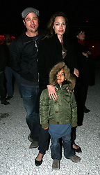 Dec 03 2007. New Orleans, Louisiana. Lower 9th Ward.<br /> Brad Pitt revisits the Lower 9th ward, devastated by Hurricane Katrina to present 'Make it Right' where architects' designs are unveiled to the public. Brad with Angelia Jolie and Maddox mingling with the crowd listening to the evening concert.<br /> Photo credit; Charlie Varley.