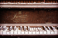 An abandoned piano inside the Alleganey State Poorhouse.