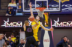 Mar 20, 2019; Morgantown, WV, USA; West Virginia Mountaineers forward Logan Routt (31) defends Grand Canyon Antelopes forward Michael Finke (43) during the second half at WVU Coliseum. Mandatory Credit: Ben Queen