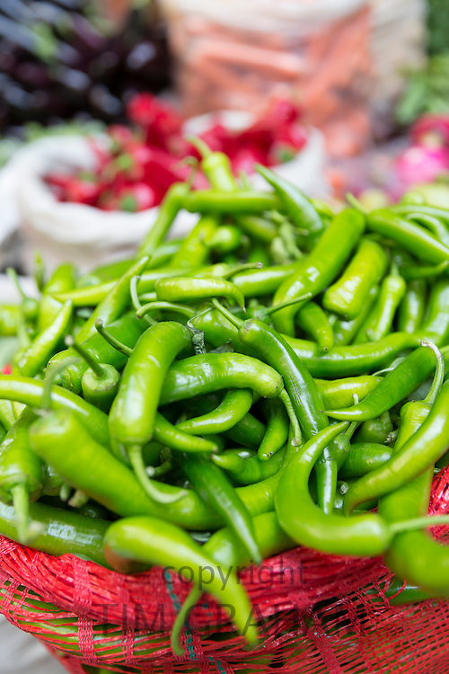 Green chillies on display for sale at food and spice market in Kadikoy district on Asian side of Istanbul, East Turkey