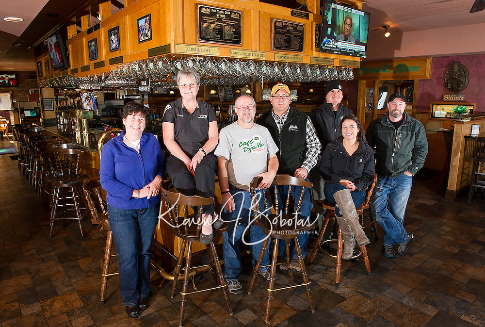 Returning team members get prepped for the Pub Mania event to benefit the Children's Auction to begin on December 8th.  (l-r Marcia Wadsworth, Lucy Jacobson, Tony Felch, Randy Remick, Matt Resca, Ashley Riopel and Keith McBey).  (Karen Bobotas/for the Laconia Daily Sun)