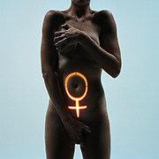 Nude woman covering body with female icon on torso