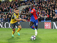 Crystal Palace's Mamadou Sakho tussles with Arsenal's Theo Walcott during the Premier League match at Selhurst Park Stadium, London. Picture date: April 10th, 2017. Pic credit should read: David Klein/Sportimage