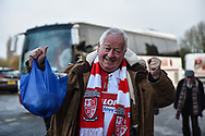 A woking fan cheers during the The FA Cup 2nd round match between Swindon Town and Woking at the County Ground, Swindon, England on 2 December 2018.