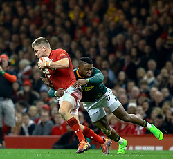 Gareth Anscombe of Wales under pressure from Aphiwe Dyantyi of South Africa<br /> <br /> Photographer Simon King/Replay Images<br /> <br /> Under Armour Series - Wales v South Africa - Saturday 24th November 2018 - Principality Stadium - Cardiff<br /> <br /> World Copyright © Replay Images . All rights reserved. info@replayimages.co.uk - http://replayimages.co.uk
