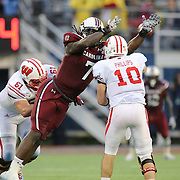 South Carolina Gamecocks defensive end Jadeveon Clowney (7) plays against Wisconsin Badgers quarterback Curt Phillips (10) during the NCAA Capital One Bowl football game between the South Carolina Gamecocks who represent the SEC and the Wisconsin Badgers who represent the Big 10 Conference, at the Florida Citrus Bowl on Wednesday, January 1, 2014 in Orlando, Florida. (AP Photo/Alex Menendez)