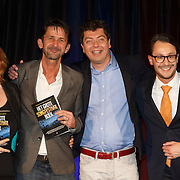 NLD/Amsterdam/20150324 -  boekpresentatie Het Grote Songfestival boek, Lenny Kurh, Cornald Maas,  Richard van de Crommert  en Dave Boomkens