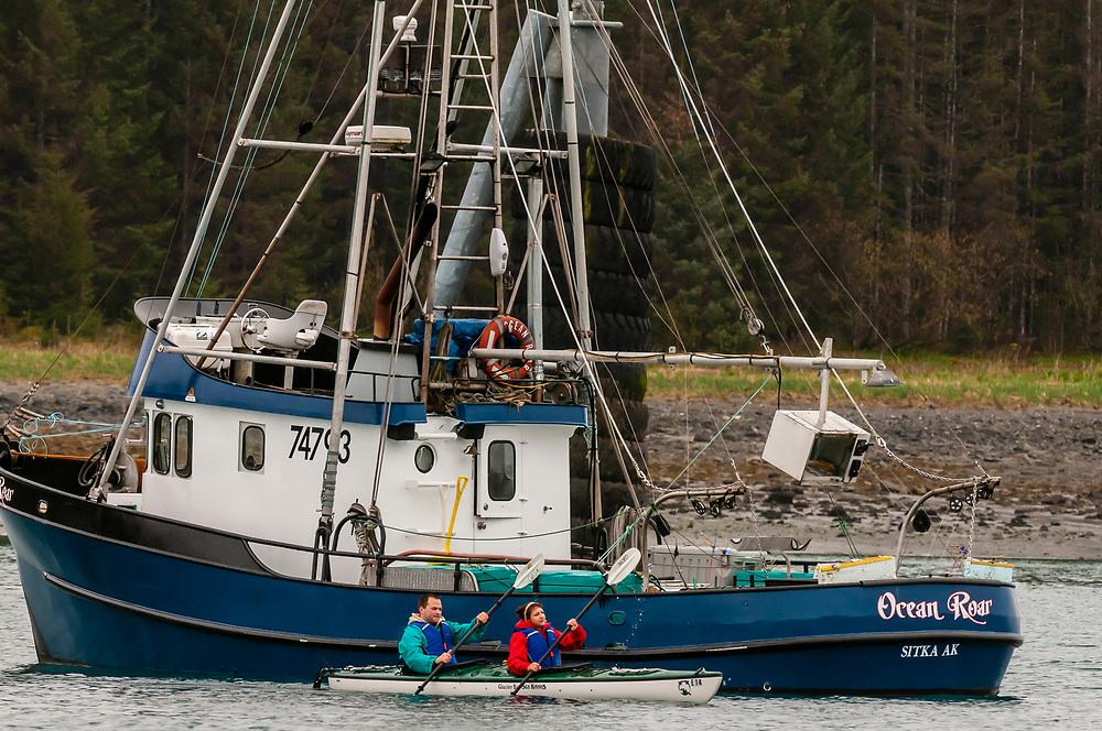 Kayakers (Glacier Bay Sea Kayaks) at Barlett Cove, Glacier Bay, near Gustavus, southeast Alaska USA