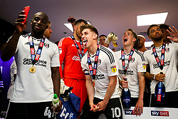 Free to use courtesy of Sky Bet. Denis Odoi takes a photo of Tom Cairney and Stefan Johansen as Fulham celebrate in the dressing room after winning the game 0-1 to win the Sky Bet Championship Play-Off Final and secure Promotion to the Premier League - Rogan/JMP - 26/05/2018 - FOOTBALL - Wembley Stadium - London, England - Aston Villa v Fulham - Sky Bet Championship Play-Off Final.