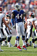 Buffalo Bills linebacker Deon Lacey (44) leaps in the air as he celebrates after tackling Denver Broncos running back De'Angelo Henderson (33) on a third quarter fake punt that gives the Bills a first down at the Broncos 31 yard line during the 2017 NFL week 3 regular season football game against the against the Denver Broncos, Sunday, Sept. 24, 2017 in Orchard Park, N.Y. The Bills won the game 26-16. (©Paul Anthony Spinelli)