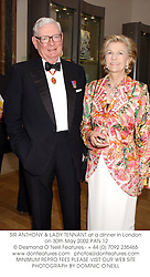SIR ANTHONY & LADY TENNANT at a dinner in London on 30th May 2002.PAN 12