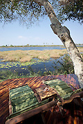 Sunloungers in the shade offer an open view at Abu Camp, a luxury camp in the Okavango Delta, Botswana